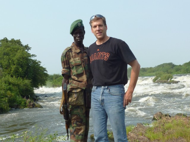 with a South Sudanese military escort visiting the Fula Rapids Micro-hyro project.